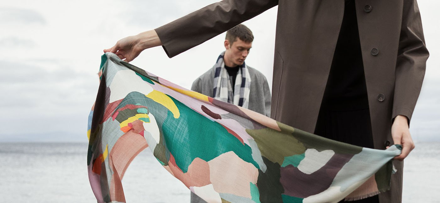 Muli coloured camouflage printed scarf blows in the wind